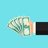 Bundle of money in hand