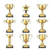 Winning golden trophy cups and sports awards vector collection isolated on white background