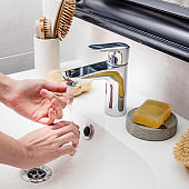 closeup of hands refreshing, cleaning and washing with tap water
