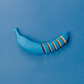Blue banana on blue pastel background. Minimal style. Food conce