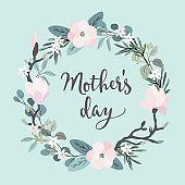 Mothers day greeting card, invitation. Brush script, calligraphic design. Floral wreath made of olive and eucalyptus leaves and magnolia flowers. Stock vector illustration