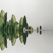 Forest treeline with water reflection made of green leaves on bright background. Minimal nature concept. Flat lay.