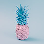 Pink pineapple on blue pastel background. Minimal style. Food co