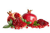 whole Pomegranates and three part of Pomegranate with leaves and seeds isolated on white