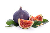 Juicy ripe figs with leaves over white