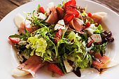 Fresh salad with parma ham and blue cheese