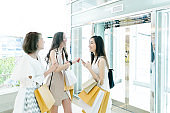 Women friends out for shopping in city malls