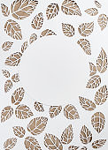 round frame on the background leaves. leaves cut from paper