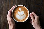 Hot latte art on wood table