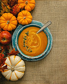 Pumpkin soup with fall season decorations