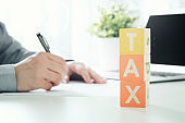 Accountant calculates tax. Working in the office