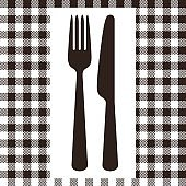 Fork, knife and tablecloth pattern in black and white
