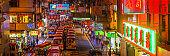 Neon city nightlife crowded streets illuminated panorama Hong Kong China