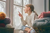 girl sitting by the window