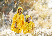 children under the autumn rain