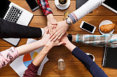 United hands teamwork in office concept