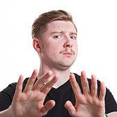 Negative human emotion, man expressing disgust