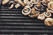 Mushroom barbecue roasted on metal grill background