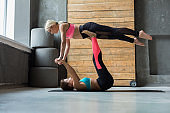 Couple practicing yoga at studio together