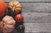 Pumpkins on gray wood background with copy space