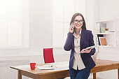 Business woman with mobile phone and tablet
