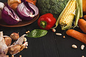 Fresh vegetables on wooden background