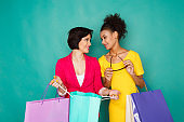 Excited multiethnic girls with shopping bags