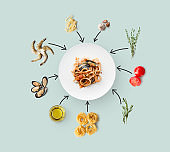 Cooking ingredients for italian food, seafood pasta, isolated on blue