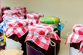 Homemade jams in glass jars for sale on country fair