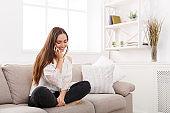 Girl at home chatting on mobile