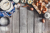 Baking ingredients on rustic wood background