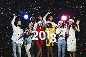 Young multiethnic people with wooden numbers 2018