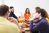 Group of happy people at festive table dinner party