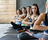 Young women in yoga class, relax meditation pose