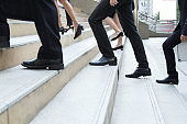 Close up legs of businessman walking stepping up stair in modern city, business growth, go up, success, grow up business concept.