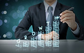 Businessman write increasing money graph with growth
