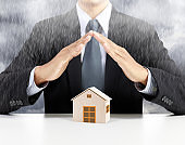 home insurance concept under rain
