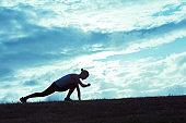 Male runner timing his run