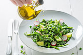 Spring vegetarian salad with spinach, radishes and asparagus