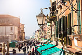 Venice Shopping street. Focus on the latnern.