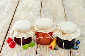 set of jams: raspberry, blueberry and peach
