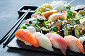 Healthy sushi mix with wasabi and soy sauce