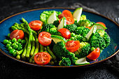 Fresh salad with cherry tomatoes, asparagus and broccoli