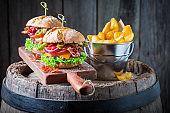Hamburger made of beef, vegetables and cheese with chips