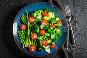 Spring salad with broccoli, asparagus and cherry tomatoes