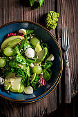 Spring kale salad with avocado, lettuce and grape