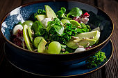 Fresh kale salad with avocado, lettuce and grape