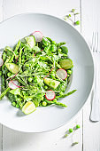Fresh vegetarian salad with spinach, radishes and asparagus