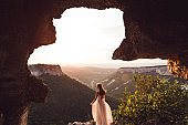 Portrait of bride in the incredible mountains at sunset light