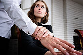 Harrassed woman dislikes his hand